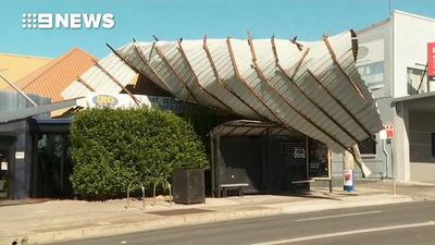 Roof blown off as wild winds tear through Sydney