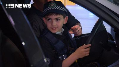 Young boy granted wish of becoming a policeman for a day