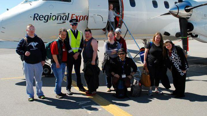 UpClub members prepare to fly to Wagga Wagga. (UpClub)