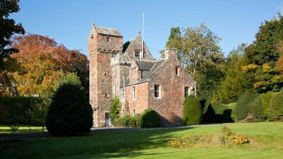 New Zealand woman selling 15th Century Scottish castle