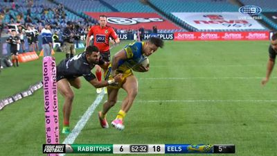 Parramatta winger Josh Hoffman squeezes into the corner to score against South Sydney