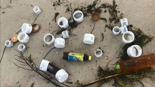 Local residents are understood to have joined the cleanup efforts. Picture: NBN News.