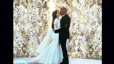 The couple said their vows before a wall of flowers (Instagram).