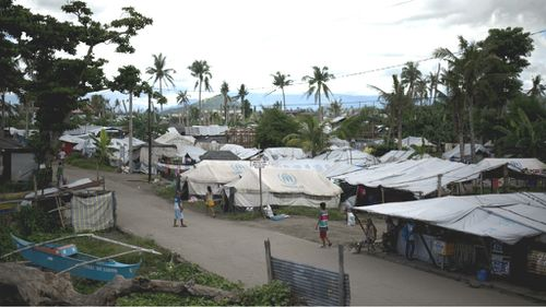 Many residents of Tacloban City are still living in tents after Super Typhoon Haiyan struck last November. (Getty)