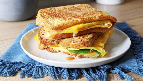 Healthy omelette eggy bread breakfast stuffed with greens and baked beans