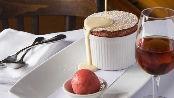 Bistro Moncur's mandarin soufflé with vanilla bean anglaise and mandarin sorbet. Image: Bistro Moncur
