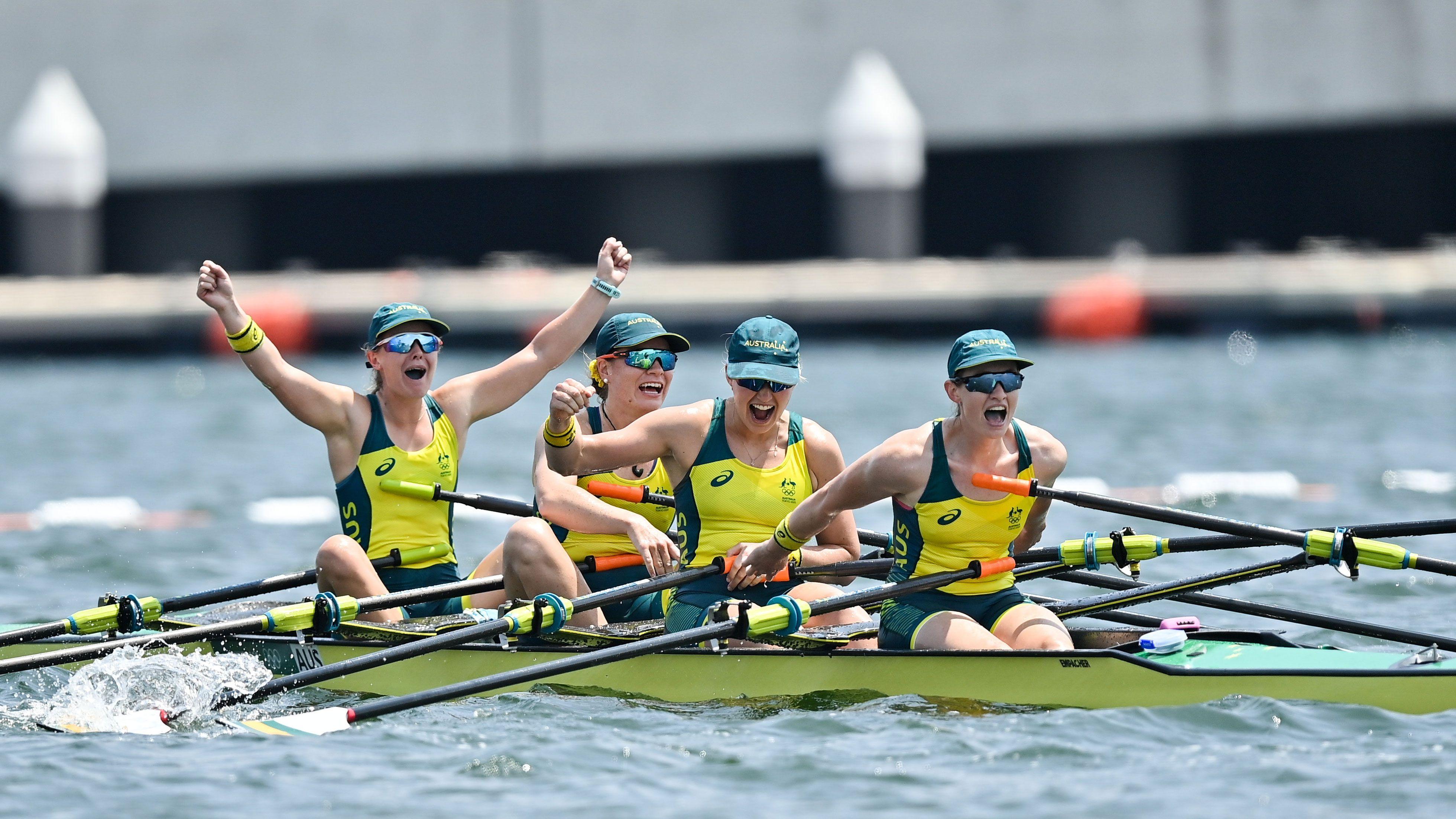 Australia's quad sculls crew celebrate a bronze medal.