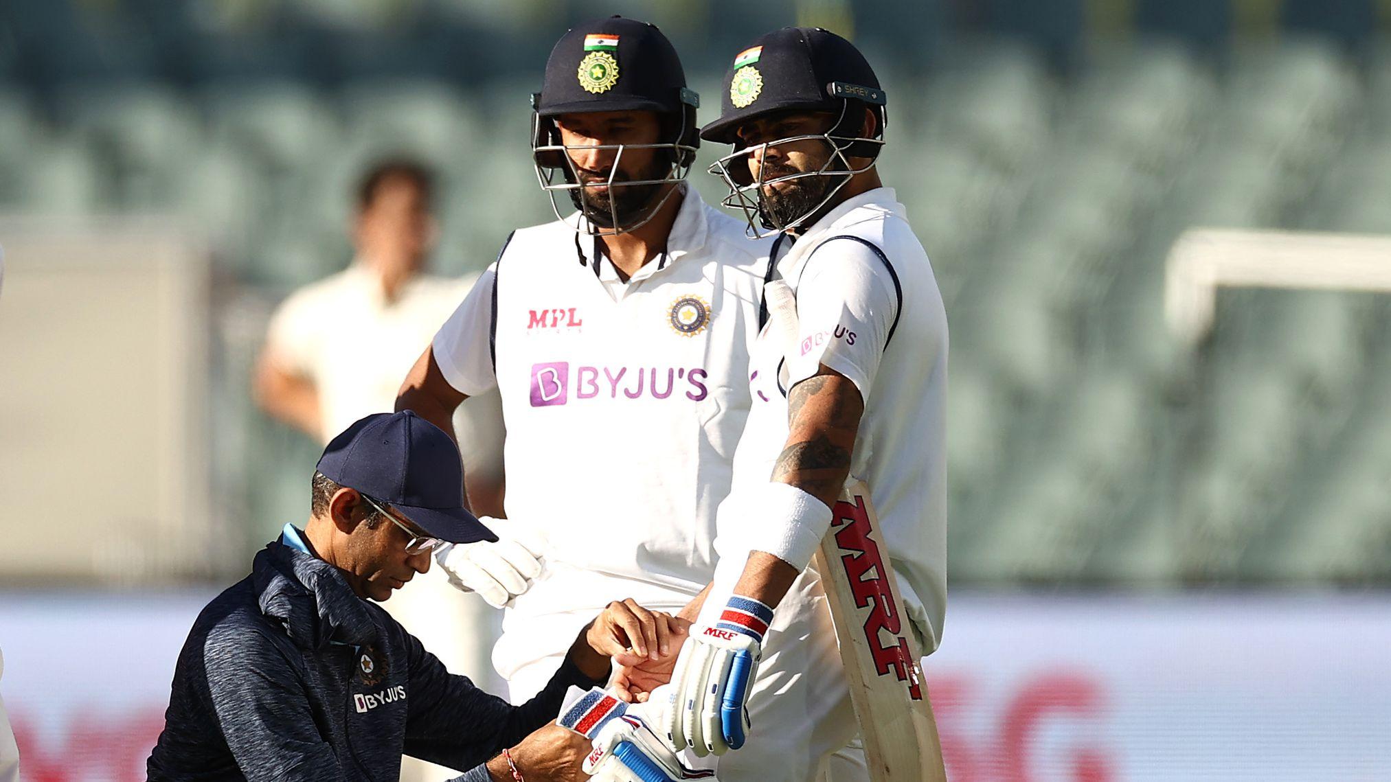Virat Kohli and Cheteshwar Pujara during their partnership at the Adelaide Oval.