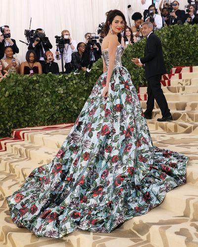 "Amal Clooney in Richard Quinn at the 2018 Met Gala <a href=""https://style.nine.com.au/2018/05/08/08/05/met-gala-2018"" target=""_blank"" draggable=""false"">Heavenly Bodies: Fashion and the Catholic Imagination</a>"