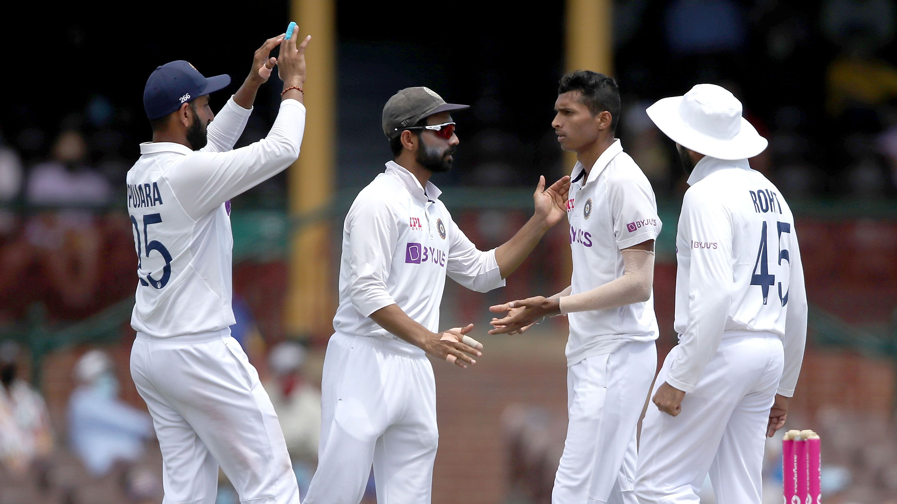 India players celebrate a wicket during the SCG Test.