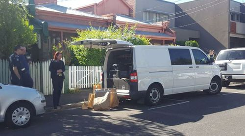 Bags of evidence were loaded into a police van. (9NEWS)