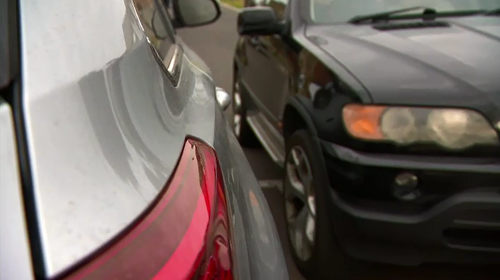 Residents say the street is too narrow to park fully on the road.