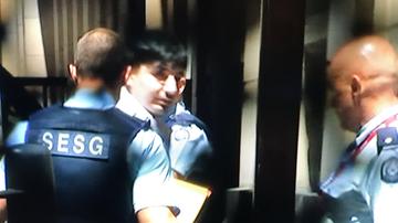 James Gargasoulas being led into court.