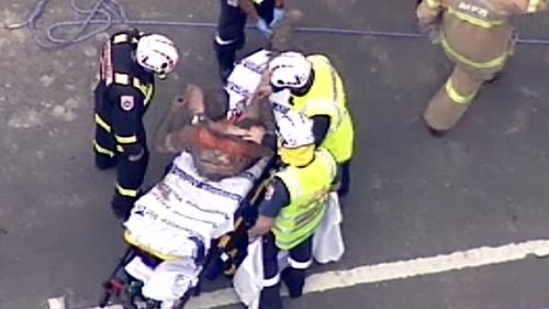 The rescued man was loaded onto the stretcher. (9NEWS)