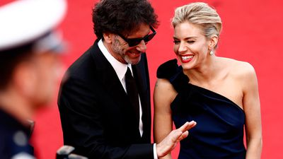 British actress Sienna Miller with one of the festival's jury presidents, director Ethan Cohen. (AAP)