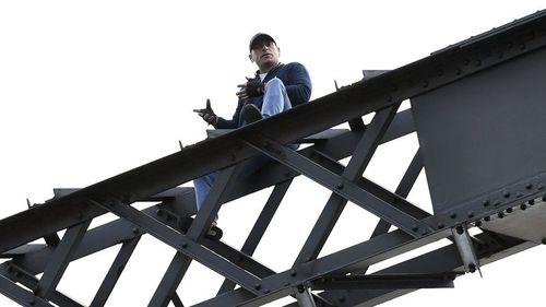 Wayne Cook, 44, climbed 75 metres up the Sydney Habour Bridge last Wednesday. (AAP)