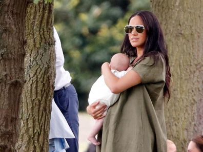 Meghan and Archie watch Prince Harry play the polo.