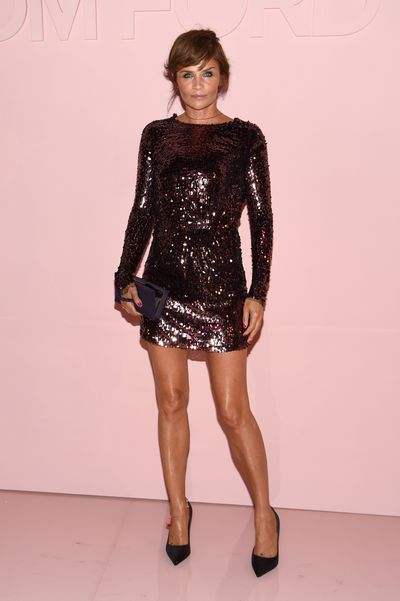Helena Christensen strikes a pose at Tom Ford at New York Fashion Week.