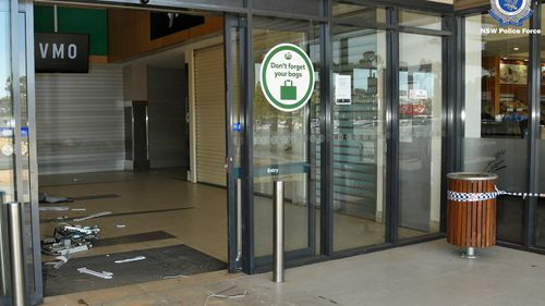 The front doors of the shopping complex in Moama that the thieves drove the bobcat through.