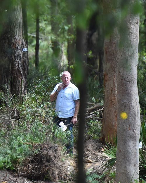 Mark Leveson stands in the bush, during one of the earlier unsuccessful searches for the burial sit of his son Matthew. (AAP)