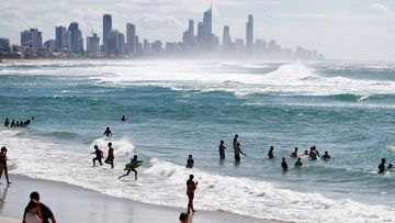 People swim at Burleigh Heads beach in Gold Coast, Australia, after coronavirus restrictions were lifted.