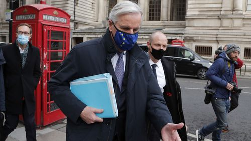 European Commission's Head of Task Force for Relations with the United Kingdom Michel Barnier walks from his hotel to the Conference Centre in London, Wednesday, Nov. 11, 2020.