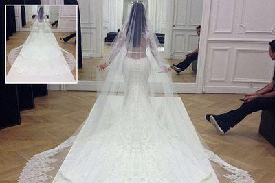 Kim showed off that famous booty in elegant bridal style!<br/><br/>Instagram: Riccardo Tisci/Givenchy/Instagram