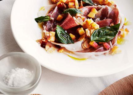 Shaved prosciutto with peach and almond salsa
