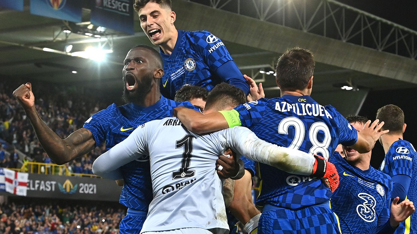 Kepa Arrizabalaga of Chelsea celebrates with teammates after making the match winning save during the penalty shoot out in the UEFA Super Cup 2021 match between Chelsea and Villarreal.
