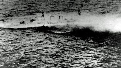 The British heavy cruiser HMS Exeter sinking in 1942. (Photo: US Navy Naval History and Heritage Command).