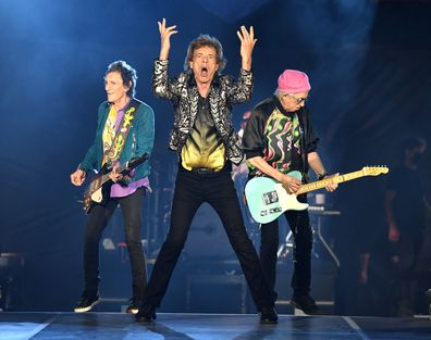 Ronnie Wood, Mick Jagger and Keith Richards of The Rolling Stones perform onstage at Nissan Stadium on October 09, 2021 in Nashville, Tennessee.