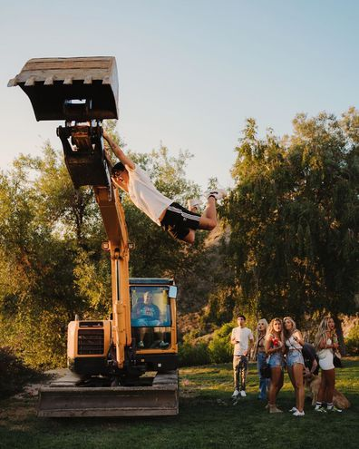 Partygoers were seen 'swinging' from heavy machinery at points during the party.