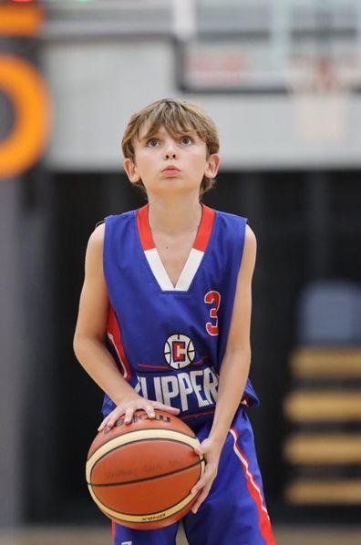 Reggie Bird son playing basketball