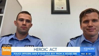 Hero police officers who saved boy from burning house speak about the rescue