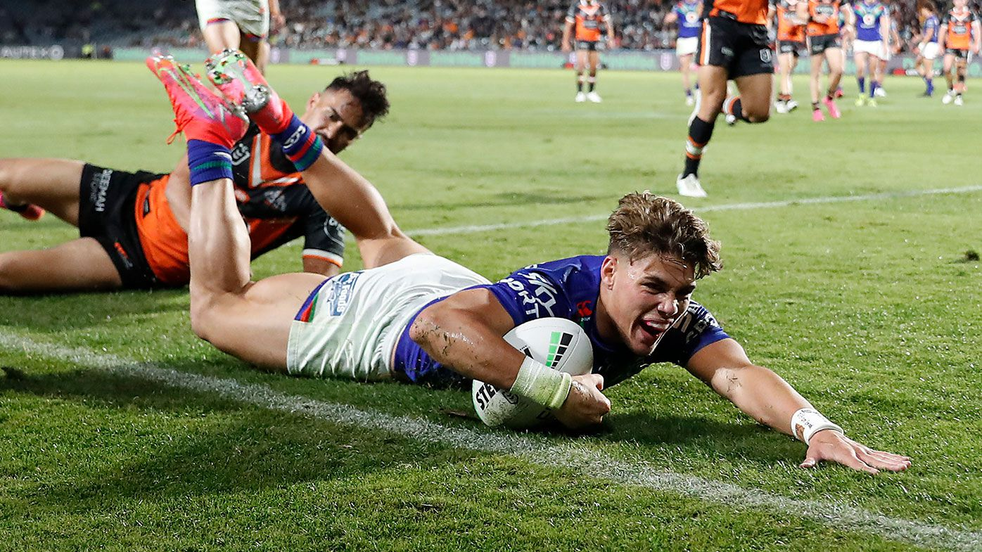 Reece Walsh of the Warriors scores a try during the round 11 NRL match between the New Zealand Warriors and the Wests Tigers at Central Coast Stadium on May 21, 2021, in Gosford, Australia. (Photo by Mark Metcalfe/Getty Images)