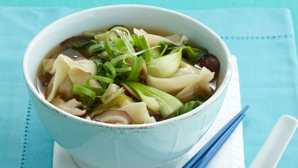 Steamed pork dumplings in chicken broth