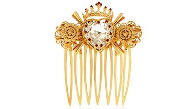 """<a href=""""http://www.net-a-porter.com/au/en/product/541354"""" target=""""_blank"""">Swarovski crystal-embellished gold-tone hair slide, $1,334.02, Dolce &amp; Gabbana</a>"""