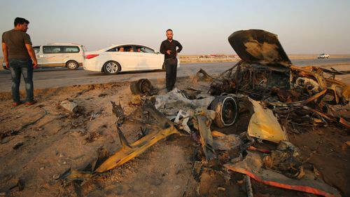 The damage at an international road in Dhi Qar, Iraq. (AFP)