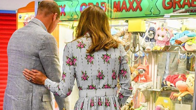 The Duke and Duchess of Cambridge have shared a sweet moment with Kate offering Prince William comfort while he attempted a difficult arcade game during an official engagement this week aimed at restarting the economy.