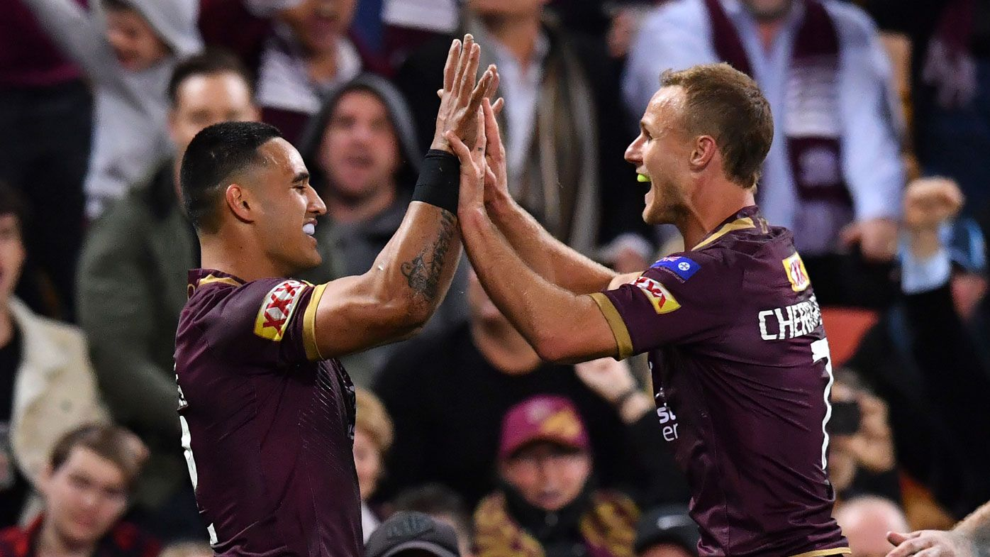 Valentine Holmes celebrates with Daly Cherry-Evans.