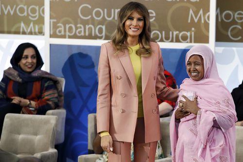First lady Melania Trump, center, presents an International Women of Courage award to L'Malouma Said of Mauritania. (AAP)