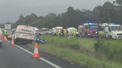 One dead, 10 injured in six-vehicle crash on the Bruce Highway, Sunshine Coast