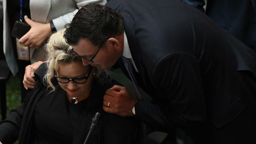 Daniel Andrews hugs Health Minister Hennessy after the assisted dying bill passed.