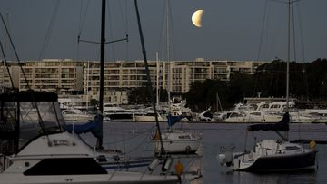 The partial lunar eclipse above Sydney.