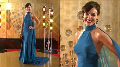 News presenter Natarsha Belling paired a floaty blue gown with chunky earrings.