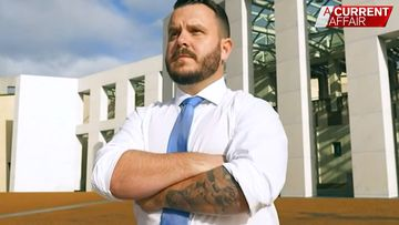 Federal pollie asked to cover tattoos as they 'intimidate' people