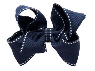 """<p>Little and big girls alike love a pretty hair decoration. Just make sure it's in school colours.</p> <p><a href=""""http://pixiespix.com.au/product/new-pre-order-medium-stitched-bow-suri-pair/"""" target=""""_blank"""">Pixie's Bows Medium Stitched Bow Suri, $24 (a pair).</a></p>"""