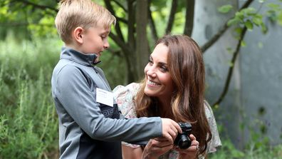 Catherine, Duchess of Cambridge speaks with Josh Evans at photography workshop for Action for Children, run by the Royal Photographic Society at Warren Park on June 25, 2019 in Kingston, England