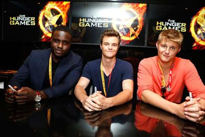 <i>Hunger Games</i> hotties Dayo Okeniyi, Jack Quaid and Alexander Ludwig at a DVD signing.
