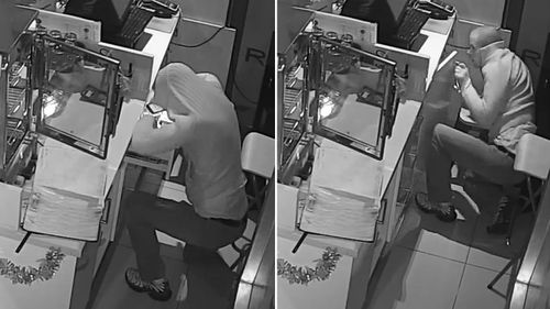 The man can be seen sneaking up to the cash register before peaking into drawers. (Victoria Police)
